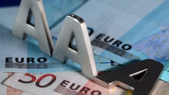 epa03063906 An illustration dated 17 January 2012 shows two A's standing and one A lying on euro banknotes in Cologne, Germany. The downgrading by the rating agency Standard & Poor's (S&P) is not detering investors from investing in the The European Financial Stability Facility (EFSF). S&P downgraded the rating of the ESFS from their best rating 'AAA' to 'AA+' on 16 January 2012.  EPA/OLIVER BERG